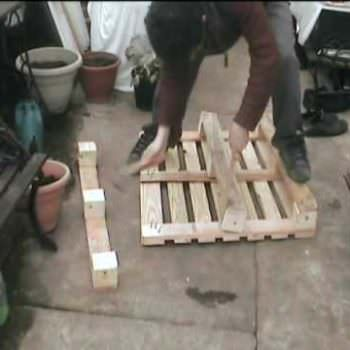 How to Easily Dismantle a Wooden Pallet with a Hammer & a Plank